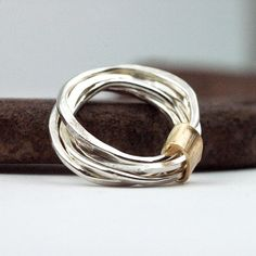 Silver Stacking Rings Wrapped in Gold - four hammered bands created from recycled metal - unique gift by @Lisa Lehmann