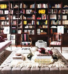 an oversized neutral upholstered ottoman and coffee table in a library