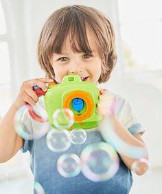 press the button, take a pretend picture, chase and pop the bubbles!