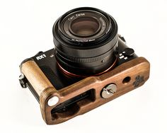 Premium Wood Grip for the Sony RX1 by J.B. Camera Designs. Our new Wood Grip is made of solid walnut and a strong metal interior post. These handcrafted Wood Grips are made in the USA and they add extra grip, protection, and look to your favorite camera. Walnut wood is a great material for camera grips because of its natural properties: great strength while being lightweight and the unique grain texture it provides for grip.  Thank you for checking out my unique – made in the USA – camera…