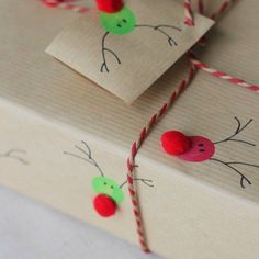 The Best DIY Gift Wrap Ideas Ever - Reindeer Prints! Get the kiddos involved in the holiday spirit by making gift wrap using their fingerprints. Just draw on eyes and antlers and add a pom-pom for dimension.