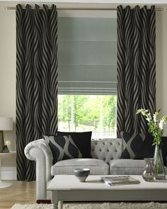 Love the different gray tones and the coordinating plows on this sleek, contemporary look.  Drapes UK 2012