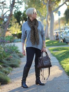 Slouchy sweater, skinny jeans, riding boots, moto bag.