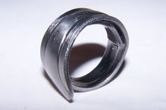 Ring fashioned from a stainless steel fork handle.  Available at: https://handmadeartists.com/shop/rasmussengems