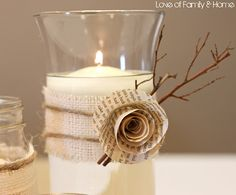 DIY rustic, fall themed unity candle idea with burlap, twine and ivory candle.