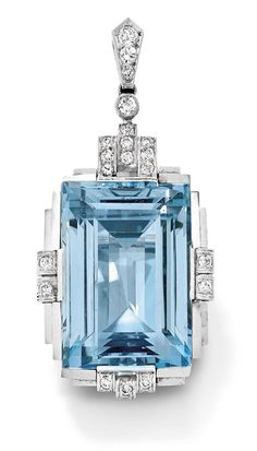 An Art Deco aquamarine and diamond pendant, 1930  The step-cut aquamarine within a polished stepped frame set with brilliant-cut diamond accents to a similarly cut diamond surmount and bail, length 4.7 cm, French assay marks.