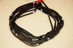 1strand  natural hematite plain stick sized 3 by 6mm by 3yes