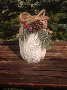 This candle holder makes a lovely holiday favor! The mason jar has been rolled in Epsom salts to create a snowy effect and sprayed with
