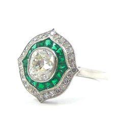 Belle Epoque style, diamond, emerald, platinum.