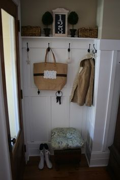 back entryway off of kitchen - wainscoting with hooks for jackets & bags