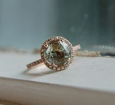 round diamond + rose gold + halo+ mint green = everything I could ever want in an engagement ring.