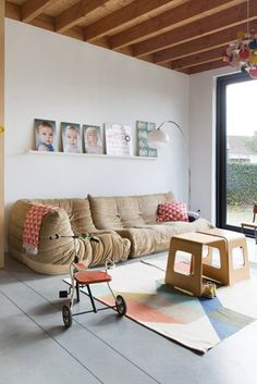 This living/play room is quite cozy! Sofa is Togo from Ligne Roset