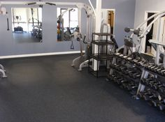 200 sq ft mirrored home gym w built in tv and rubber for Best flooring for home gym in basement
