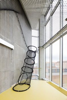 For the Ku.Be House of Culture and Movement in Copenhagen and Adept a Danish firm encourage unconventional movement by incorporating a rock climbing wall fireman poles and netted ladders.: - Architecture and Home Decor - Bedroom Education Architecture, Interior Architecture, Interior And Exterior, Landscape Architecture, Room Interior, Playground Design, Indoor Playground, Casas Containers, Kid Spaces