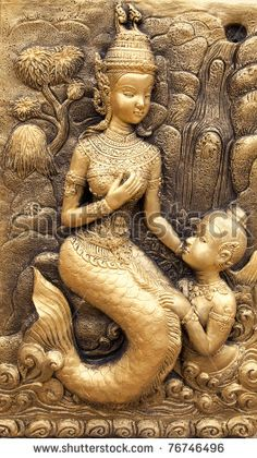 Low-relief image of Thai traditional art illustrated mermaid and son from a…