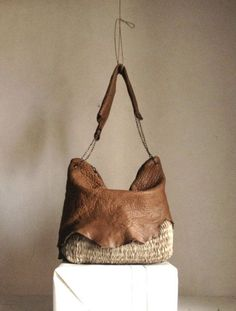 Loving this bag...It can even hold an emergency diaper or two and still be a gorgeous accessory! #Mommystyle