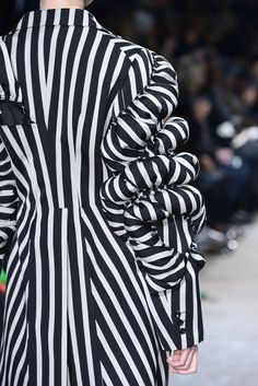 Sculptural Fashion with 3D sleeve detail and use of stripes for added dimensionality; shape, pattern, structure // Comme des Garcons