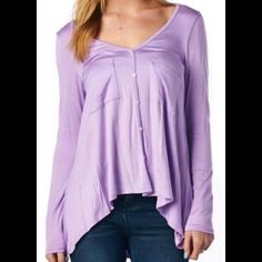 """"""" Lilac So Good"""" Such a pretty lavender purple with oh so soft buttery material that you and your body will absolutely love. You will not want to take this top off. I even kept one for myself. This top features long sleeves and a high-low hem. The last pic is true color. A lilac/pink color. Chic Couture Tops Tees - Long Sleeve"""