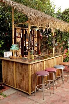 When we decided last summer that our backyard had been Tiki bar-less for far too long, we called upon our good buddy Dustin to construct us the thatch… - New Deko Sites Beach Lounge, Tiki Lounge, Backyard Bar, Patio Bar, Pool Bar, Bar Pallet, Bars Tiki, Outdoor Tiki Bar, Outdoor Bars