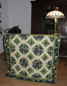 """The block in this quilt is from the 2013 issue of """"Quiltmaker's 100 Blocks"""" and is called Lovely Garden by Debbie Caffrey."""
