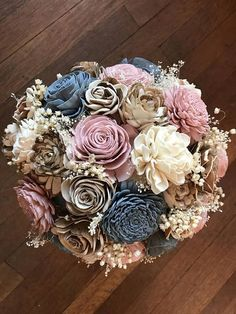 Dusty blue and rose sola flower bouquet, wedding flowers Beautifully natural sola wood flower bouquet hand dyed in shades of dusty blue, dusty rose and champagne. This bouquet is full of a variety of sola blooms and accented with dry babies breath and filler. The wire stems are #weddingflowers