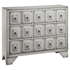 An eye-catching addition to your master suite or den, this glamorous chest showcases an apothecary-inspired design and weathered drawer fronts.