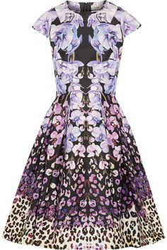 Temperley.  This is a beautiful dress that combines so many patterns and floral tones and even a bit if leopard print (which we love).  You might think such a combination would be borderline offensive but it really works and is incredibly classy.  Pair with simple jewelry for a stunning ensemble.