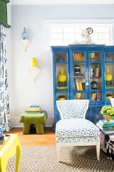 Blue lacquer vintage bookcase, blue and white leopard chair, yellow ginger jar vases, Chelsea House brackets, Parker Kennedy Living, Southern Style Now, Traditional Home Magazine designer Showhouse