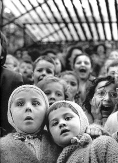 """Eisenstaedt  Children at Puppet Theatre  Children Watching the Story of """"Saint George and the Dragon"""" at the Puppet Theater in the Tuileries, Paris, 1963"""