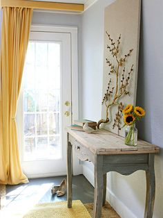 We love this light filled entryway! More decorating ideas: http://www.bhg.com/decorating/small-spaces/homes/