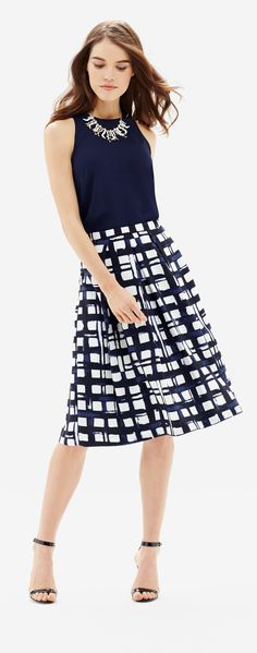 High Waist Printed Midi Skirt- A tasteful length with feminine flare! Pair this painterly print with a navy or white sleeveless top for your next gala event.