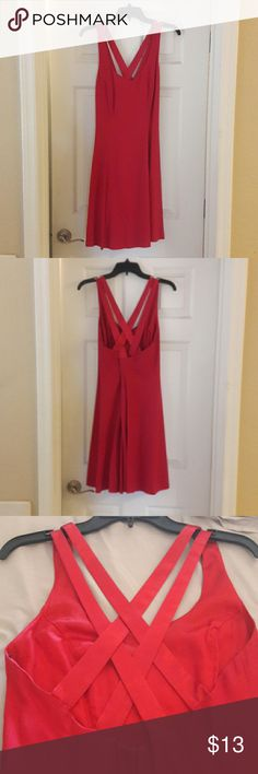 Womens Red dress Stunning womens red dress. Size 10. Criss cross straps in the back. CDC Dresses