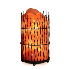 As this salt lamp warms up with the light bulb it emits negative ions into the air. Negative ions cause harmful air particles to clump together and fall to the ground. This process may help relieve sy