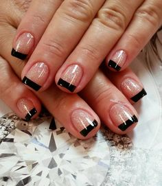 Black and glitter French tips. Let your nails look fierce by adding black as the French tip color and enhancing it by using glitter polish as the base.