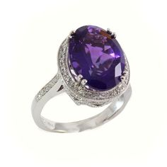 14kt white gold ring set with an oval 9.54ct amethyst in a halo of 0.22ctw round brilliant cut diamonds. LCR01425. #jewelry #amethyst
