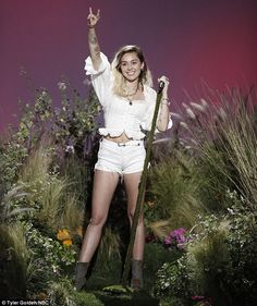 Miley Cyrus dedicated a rendition of Malibu to her 'good friend' Ariana Grande after 22 people were killed and 119 were injured in a suspected terrorist attack after her gig at Manchester Arena