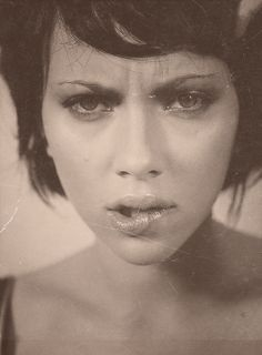 Scarlett Johansson black and white portrait. She looks good with dark hair too!