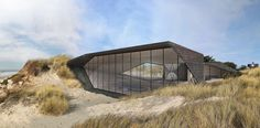 'Deeply embedded in a context of coastal sand dunes, Dune is a weekend house that allows sand to drift over and around it.  The house is a synthetic dune, it...