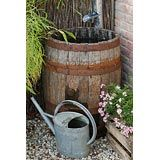 rain barrel and water can