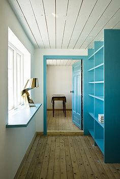 Never thought of baby blue shelving- Farmhouse in the southernmost Swedish region of Skåne, converted into a summerhouse by LASC Studio, a Copenhagen-based office founded in 2007 by the Swedish/German architect Jonas Labbé and the Dutch architect Johannes Schotanus.  Photography by Laura Stamer.