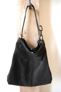 ead10c511873 This Owen Barry slouch bag is beautifully simple and stylish with its  practical features and supple