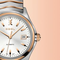 EBEL Wave Gent automatic   Men's EBEL Wave Gent automatic watch, 40.0 mm stainless steel and 18K rose gold contoured case, silver galvanic dial with applied EBEL symbol and indexes, and date display, brushed and polished two-toned stainless steel signature wave-link bracelet with deployment clasp, Swiss self-winding mechanical movement, anti-reflective sappphire crystal, water resistant to 50 meters.