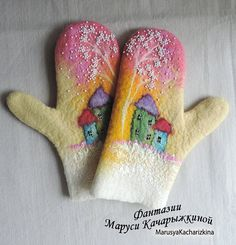 Handmade felted mittens Very warm and soft Decorated with beads  ██ MEASUREMENTS (see photo diagram)██ █ A= 12 cm █ B= 11 cm █ C= 6 cm █ D= 22,5 cm █ E= 9 cm   You can wear and do whatever you want playing snowballs, skiing, skating and making snowman  Handwash in warm water