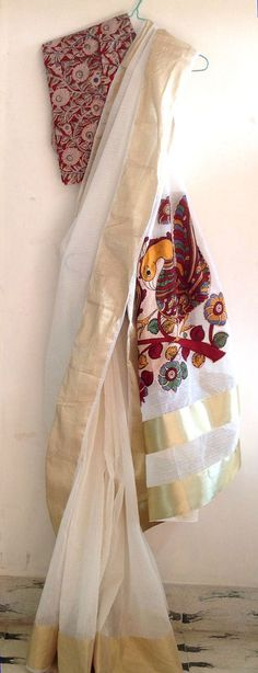 White net kota saree with gold border and kalamkari applique pallu with unstitched kalamkari printed blouse fabric