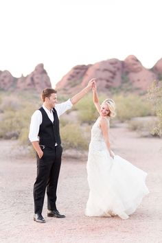 Bride and Groom Dancing in the Desert in a Wedding Dress Made for Twirling | Amy and Jordan Photography | http://heyweddinglady.com/retro-glam-wedding-shoot-poppy-red-gold/
