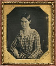 I luv this image. It is so full of soul. The angle at which the young woman is holding her head and the placement of the camera produced something special. I wish I knew her name. The plaid indicates the 1850s, and the neckline is super sweet.