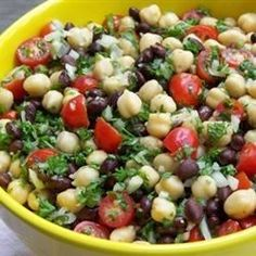 This quick Middle Eastern-style bean salad, made with garbanzo and black beans, plus lots of sweet grape tomatoes, has a tangy and slightly spicy blender dressing. Balela Salad Recipe, Mexican Bean Salad, Main Dish Salads, Stuffed Jalapeno Peppers, Tomato Salad, Middle Eastern Recipes, Mediterranean Recipes, Healthy Salads, Soup And Salad