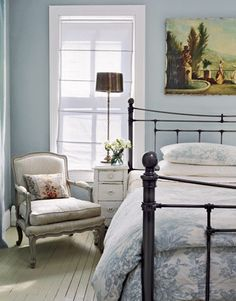 I've almost got this going on in my own bedroom. Iron bed, blue toile duvet, blue-grey-green walls, white trim. Need the beautiful side chair, the old landscape painting over the bed, and the lack of clutter. (That last one always gets me.)