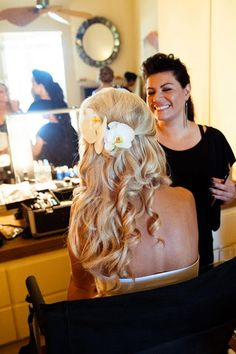 Wedding hair half-up with fresh flowers
