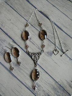 Check out this item in my Etsy shop https://www.etsy.com/uk/listing/540998577/celtic-knot-jewellery-set-necklace-and